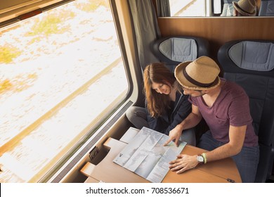 Travelers planning a trip on a train