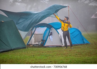 Travelers are repairing tents During the rainy