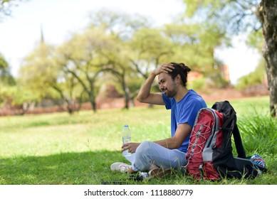 Traveler's sitting at a garden