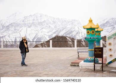 Travelers thai women people travel visit and respect praying buddha at Shanti Stupa on a hilltop in Chanspa at Leh Ladakh Village in Jammu and Kashmir, India