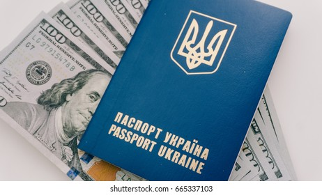 Travelers from Ukraine with dollars in a foreign passport close-up white background.