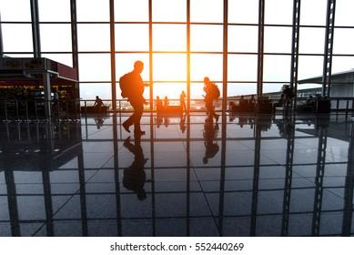 Travelers walk through an airport terminal