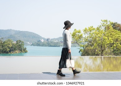 traveling Asian woman at the outdoor in daytime