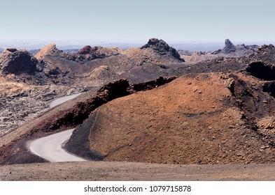 Traveling between volcano hills in Lanzarote.