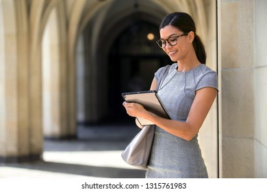 Traveling business woman on smart tablet computer, connected to broadband internet network wifi