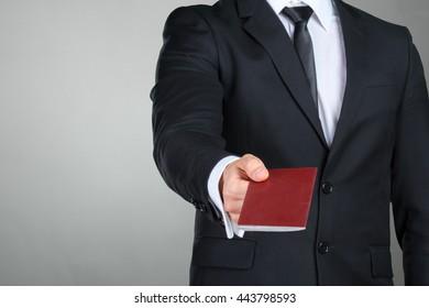 Traveling businessman handing passport