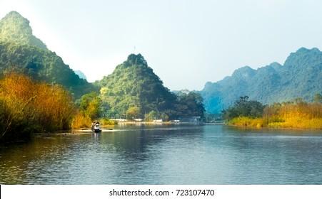 Traveling by boat on streams YEN in Hanoi, Vietnam.