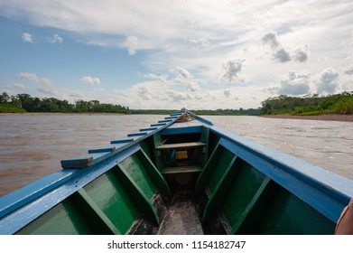 Traveling by boat in Tambopata National Reserve, Peru