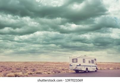 Traveling by motorhome in american prairie, Utah, USA