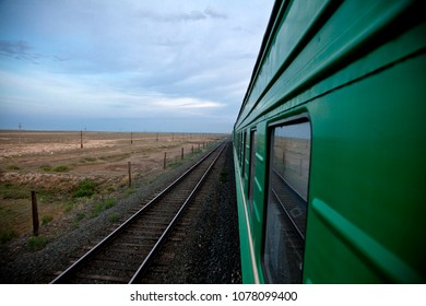 Traveling by train  through the steppe of Kazakhstan. View from outside