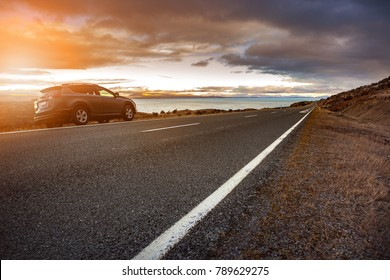 traveling car and beautiful scenic of lake pukaki in aoraki - mt.cook national park new zealand