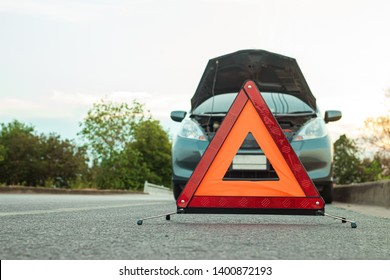 Traveling, but cars crash along the highway in the evening. Should open the hood and bring the emergency symbol to the ground to warn other cars to be careful.