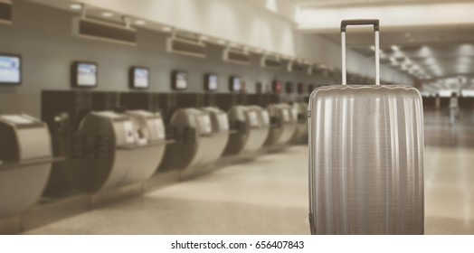 Traveling concept: Modern luxury suitcase at check in of International Airport. Selective focus.