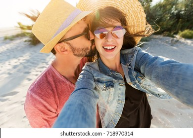 Traveling couple in love   making self portrait by digital camera , having fun on  amazing tropical beach.