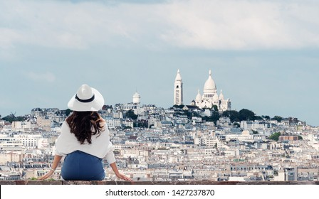 Traveling in Europe, Young woman in white hat looking at Sacré-Cœur, famous landmark and travel destination in Paris, France in summer