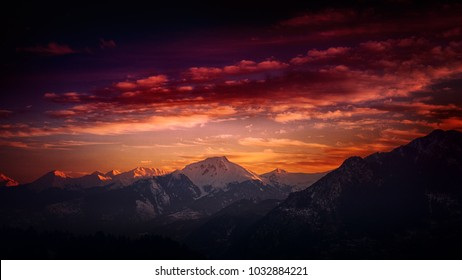 traveling evening clouds over  snow covered mountains