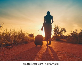 Traveling girls are traveling with luggage. Through nature tourism. (Travel ideas)