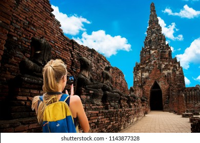 Traveling girls are taking photos at Chaiwatthanaram temple of Ayutthaya in the Thailand. ayutthaya historical park, Ayutthaya,  Thailand.