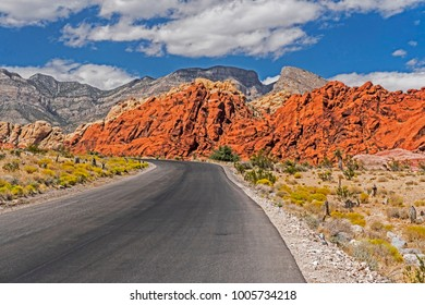 Traveling a highway through the red rocks of the Valley of Fire State Park.