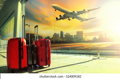 traveling luggage in airport terminal building and jet plane flying over urban scene