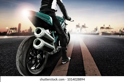 traveling man riding big motorcycle on urban road