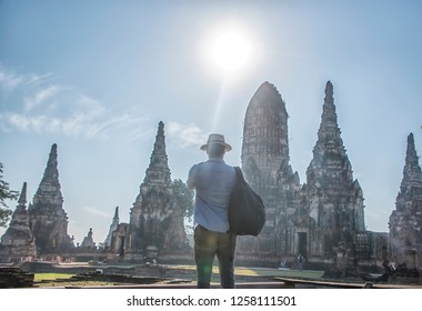 Traveling man are taking photos at Chaiwatthanaram temple of Ayutthaya in the Thailand. ayutthaya historical park, Ayutthaya, Thailand