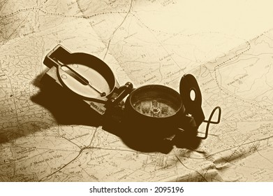 Traveling: map and compass. Sepia tone, old feel. Copy space available up right. See example in my galery.