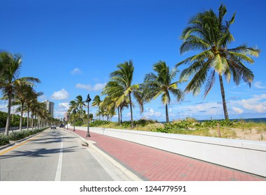 Traveling north, State Road A1A runs along the Atlantic Ocean in Fort Lauderdale, Florida.  Sand dunes and white walls protect the road from King Tides and large waves.