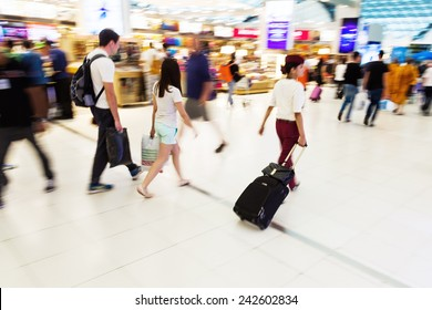 traveling people at the airport in motion blur