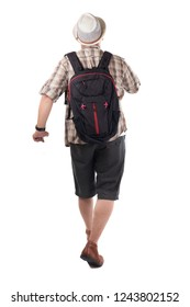 Traveling people concept. Portrait of Asian male backpacker traveler tourist  isolated on white. Full body portrait. Walking forward rear view
