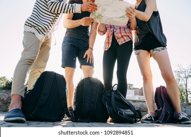 Traveling, sightseeing, group travel, city tour, student exchange program, togetherness. People with backpacks and city map