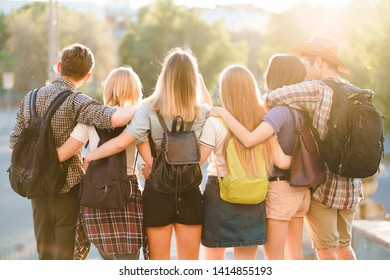 Traveling, sightseeing, vacation, holidays, adventure, friendship, togetherness Happy young people hugging looking at city view