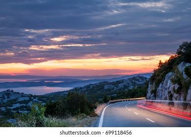 Traveling in sunset on the mountain road, Dalmatian coast, Croatia