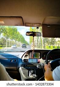 Traveling with taxi in the streets of Bishkek, Bishkek, Krygyzstan, 08.06.2019