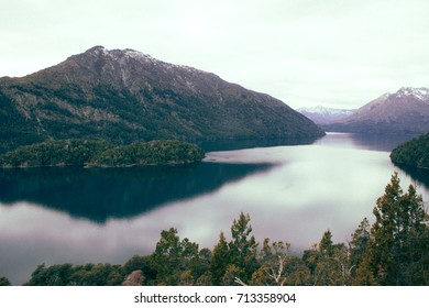 Traveling through the south of Argentina, Bariloche, the mountains reflected in the lake and the snowy peaks