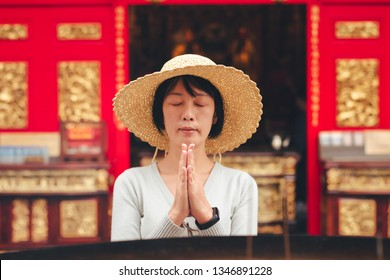 traveling woman burn incense and pray in Wenwu temple, Taiwan