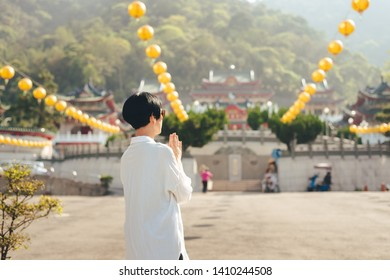 traveling woman praying at BaoHu Dimu Temple at Puli, Nantou, Taiwan, Asia