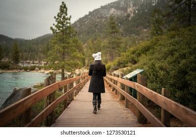 Traveling women exploring sand harbor Lake Tahoe California in the winter.