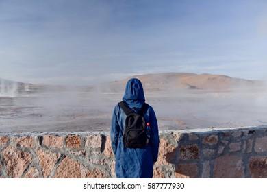 Traveling young woman. El Tatio geysers , near San Pedro de Atacama, Chile