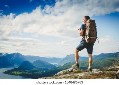 Traveller with backpack and mountain panorama