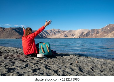 Traveller backpack woman on the beach , rest and relaxing time concept.