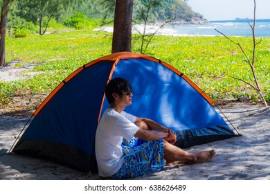 Traveller camping on the beach.