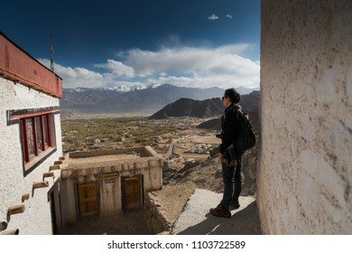 Traveller enjoying the views of a mountains landscape in Leh, Ladakh, India.