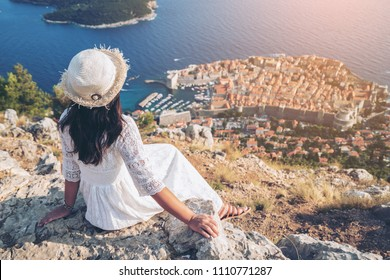 Traveller looking at view of Dubrovnik city, in Dalmatia, Croatia, the prominent travel destination of Croatia. Dubrovnik old town was listed as UNESCO World Heritage Sites in 1979.