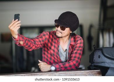 Traveller selfie and smiling in shop