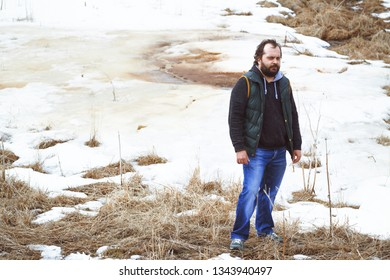 Traveller standing in the field with snow