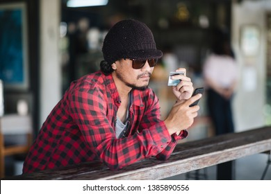 Traveller using smartphone and credit card