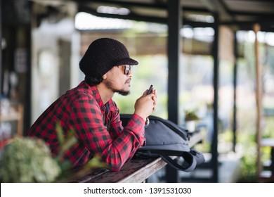 Traveller using smartphone in shop