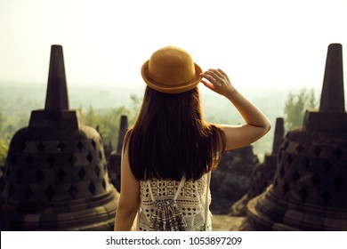 A traveller visiting Borobudur Temple in Yogyakarta, Java, Indonesia