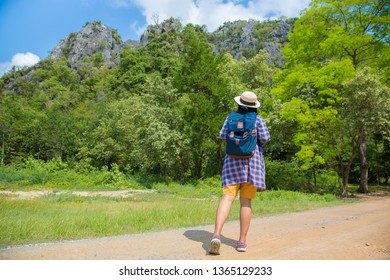 Traveller woman enjoy treking in forest on mountain,Tourism on travel in thailand